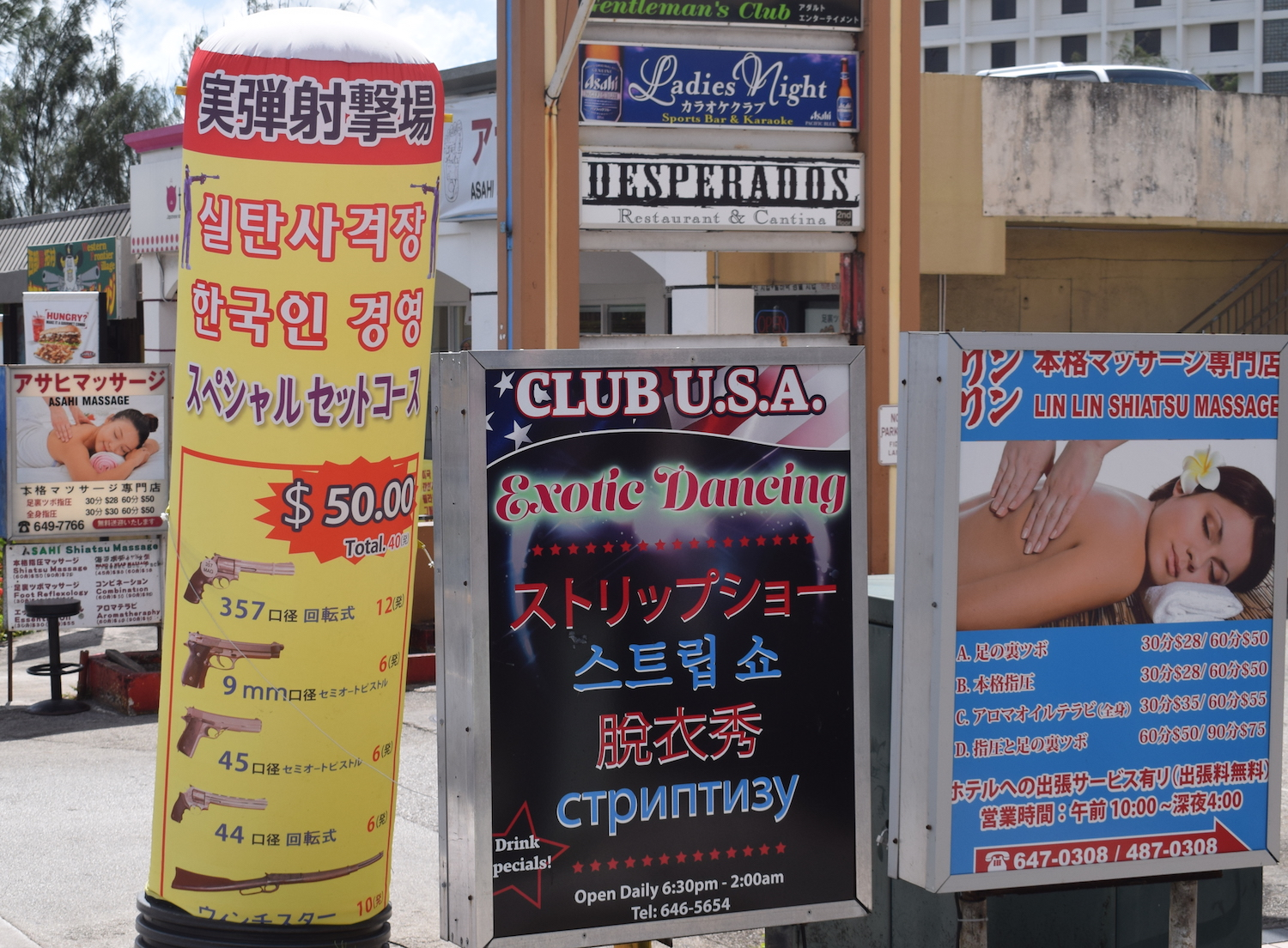 Adverts for guns and strippers in Guam