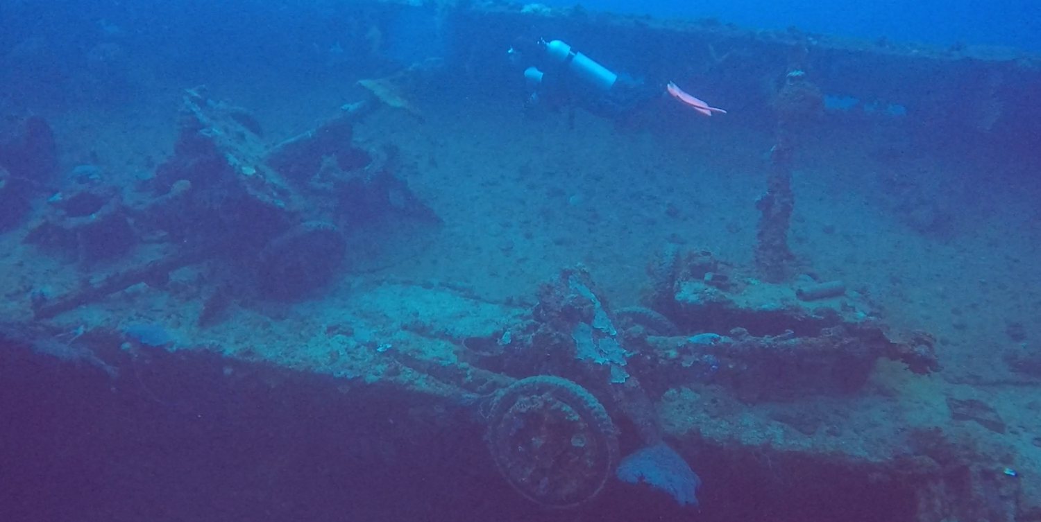 Anti-tank guns inside a ship wreck at Truk Lagoon