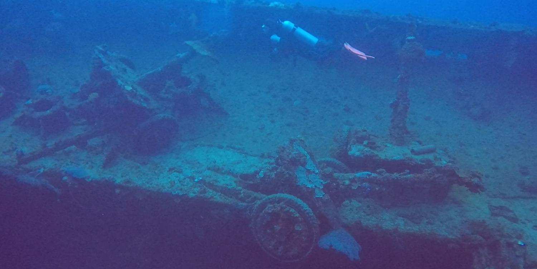 Anti-tank guns inside a ship wreck at Truk Lagoon